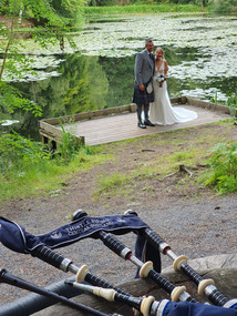 Wedding Piper at Scottish Elopement at Dunmore Loch, Scotland. Bagpipes. Thistle Piping Central Scotland