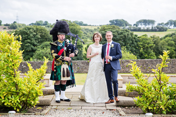 Piper with Bride and Groom