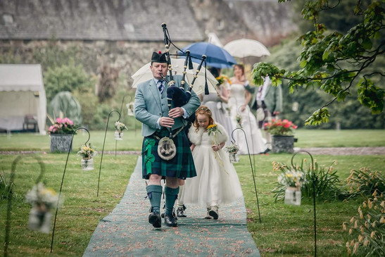 Bagpiper leading Bridal Party