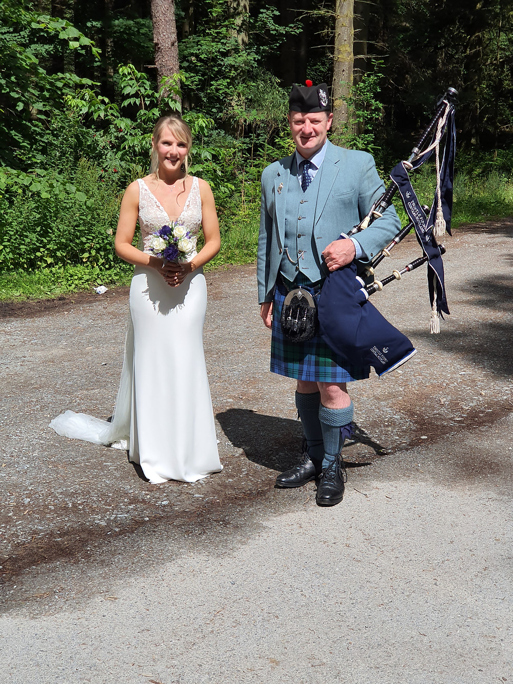 scottish elopement Bride Jennifer and wedding piper Drew Sinclair, Thistle Piping Central Scotland. Dunmore Loch