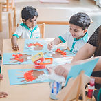 Children are workin on an arts and crafts activity in an international school.