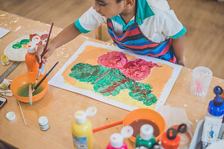 A child in a Montessori international school is working on an extra curricular activity.