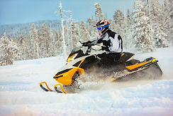 rider-gear-with-helmet-drifting-snowmobile-deep-snow-surface-background-snowy-landscaping-