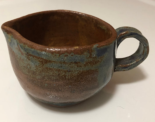 Brown and blue cream pitcher