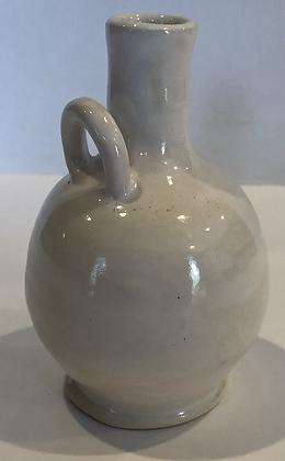 White potion bottle bud vase