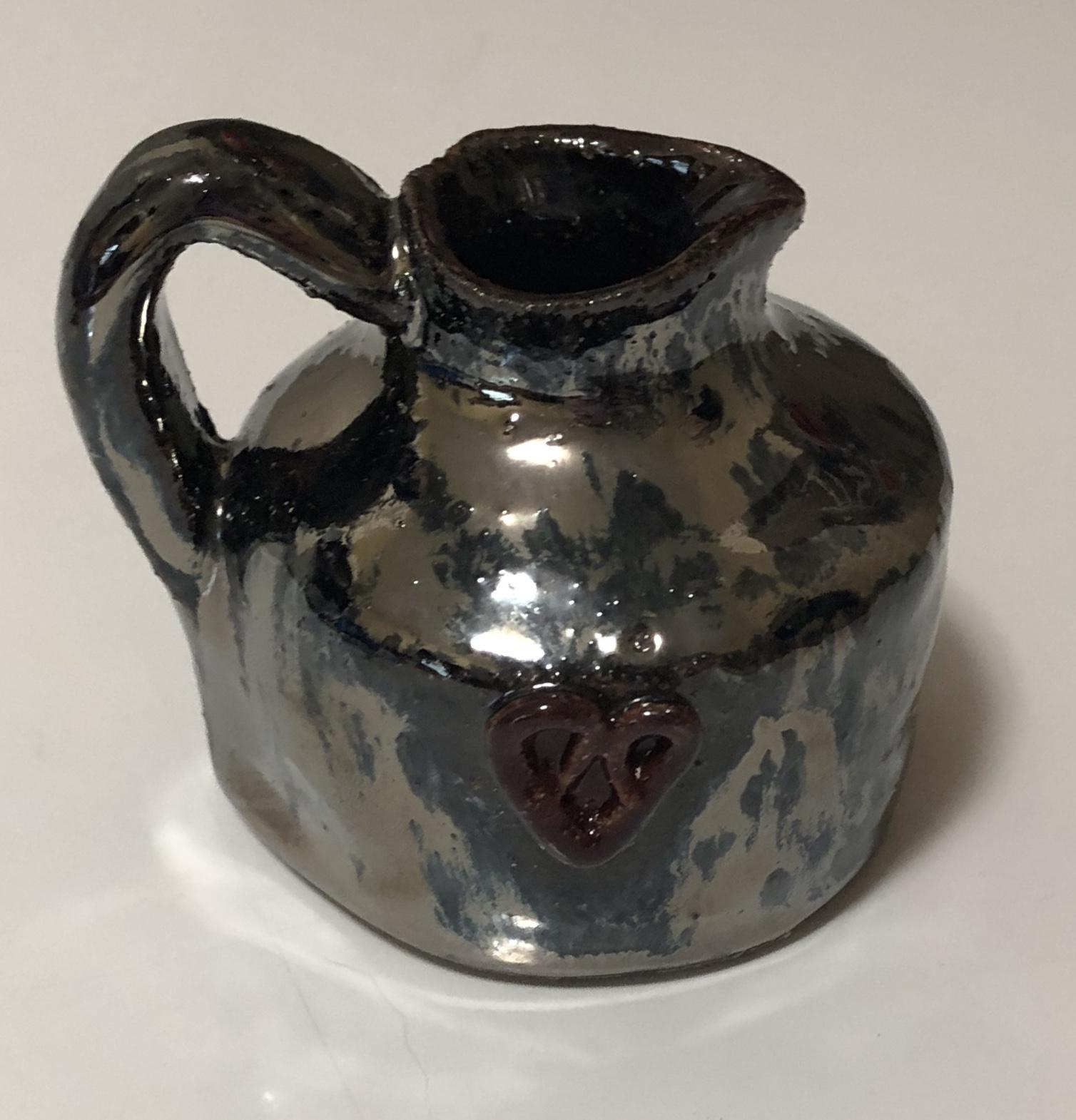 Tiny metallic pitcher
