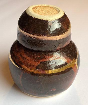 Gold embellished sake bottle