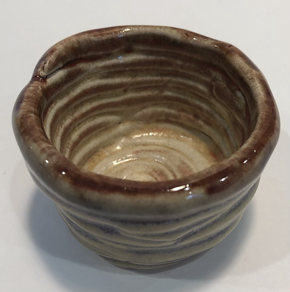 Coil shot cup