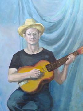 Портрет молодого человека с гитарой