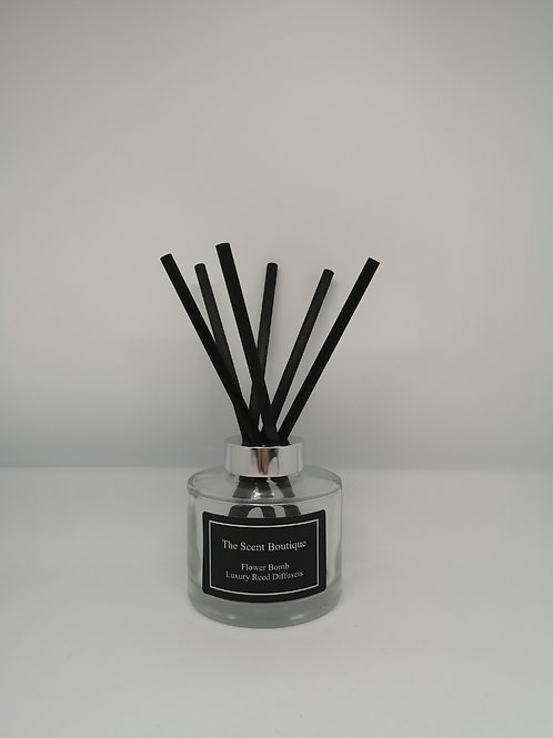 Large Luxury Reed Diffuser with silver cap and black reeds.