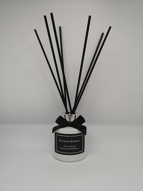 White Glass Luxury Reed Diffuser with Silver cap and black reeds.