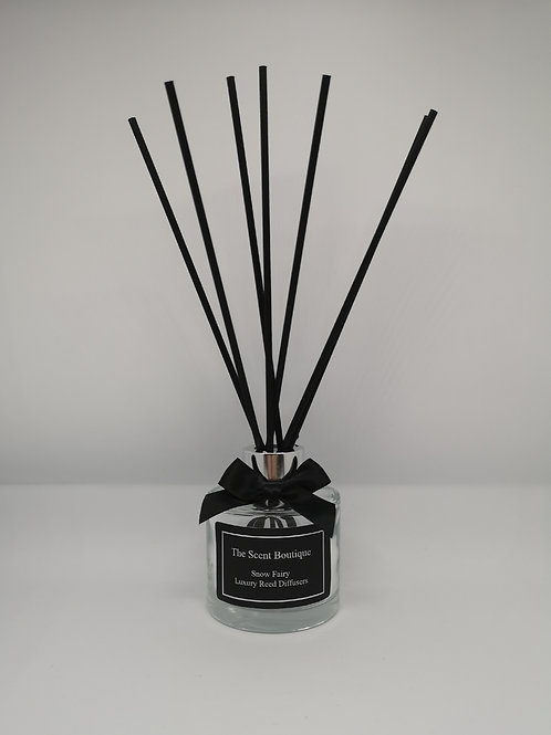 Clear Glass Luxury Reed diffuser with silver cap and black reeds.
