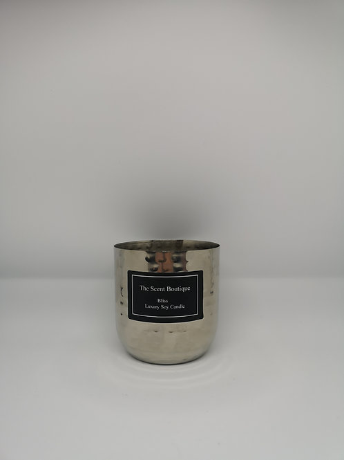 Silver metal two wick candle.