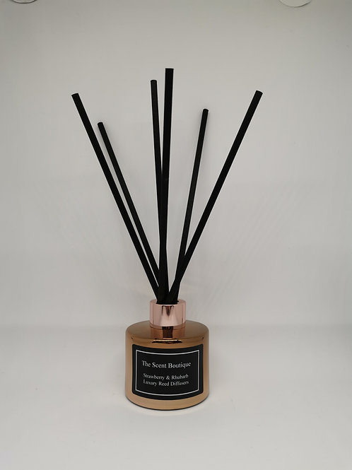 Rose Gold Luxury Reed Diffuser with rose gold cap and black reeds