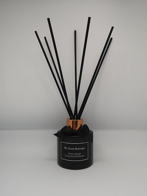 Black Glass Luxury Reed Diffuser with rose gold cap and black reeds