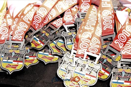 medallas con abridor de cerveza del cerro de la cruz