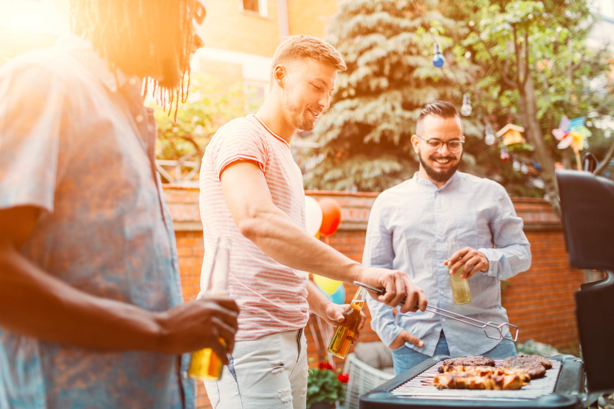 Group of friends enjoying a BBQ party with a smoker grill combo grill