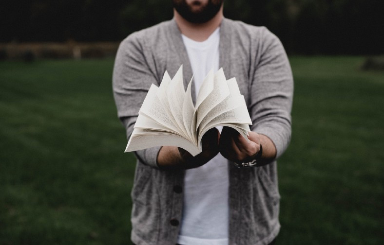 Man flipping book pages - out loud!