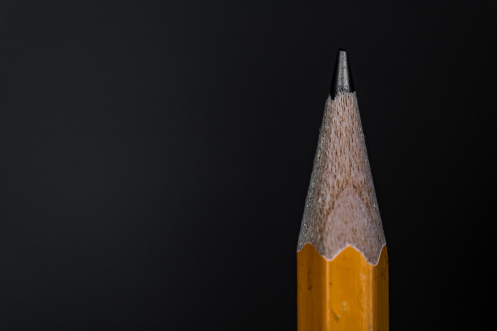 Pencil point on black background