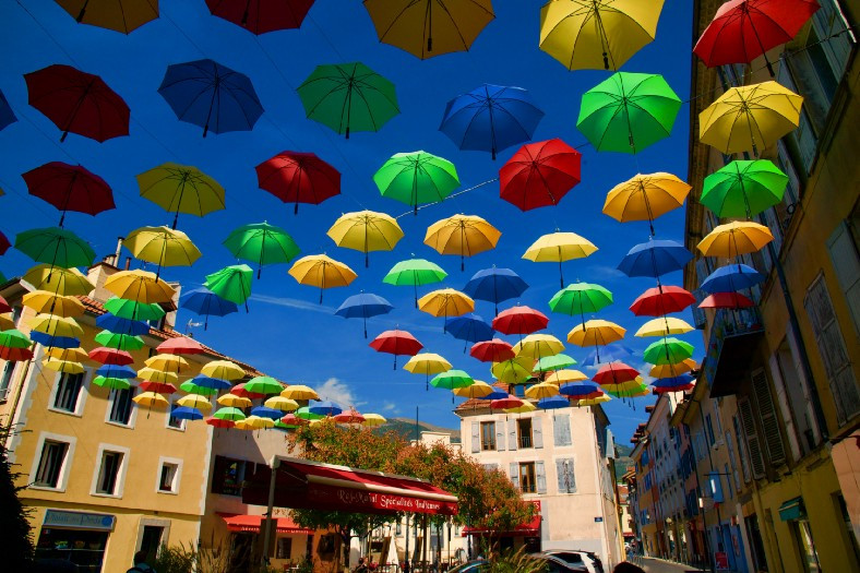 Brightly colored umbrellas suspended over street