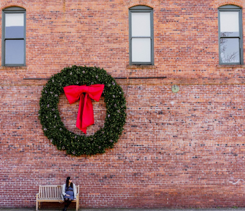 Large wreath on brick building wall