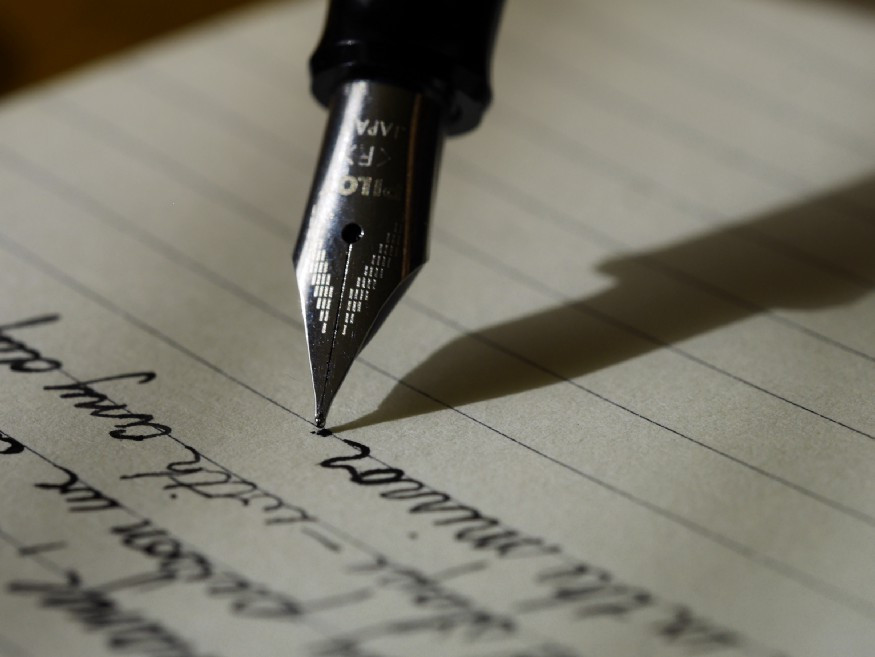 fountain pen writing a letter