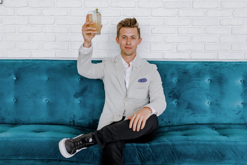 Man toasting success and high Q-Factor