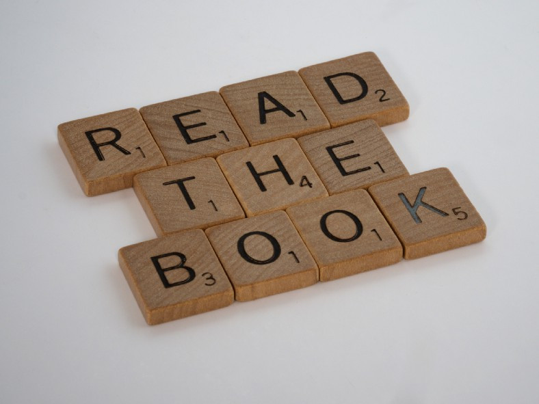 """Scrabble tiles saying, """"Read the Book."""""""