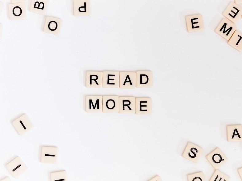 "Scrabble tiles that say, ""Read More."""