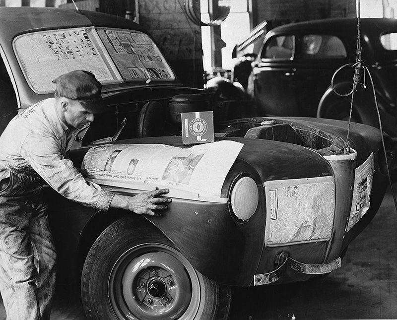 "Vintage photo of painter ""masking"" a car"