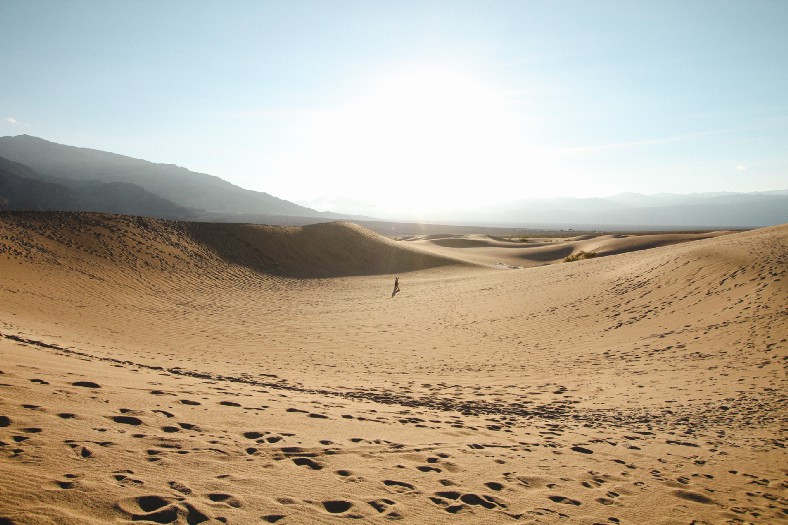 Sand dunes with lone figure