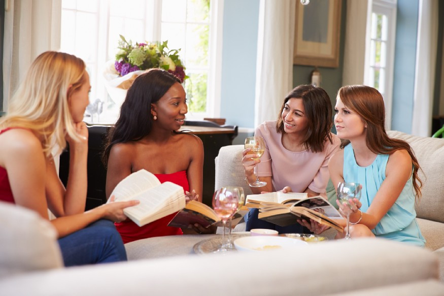 Four women talking books and drinking wine