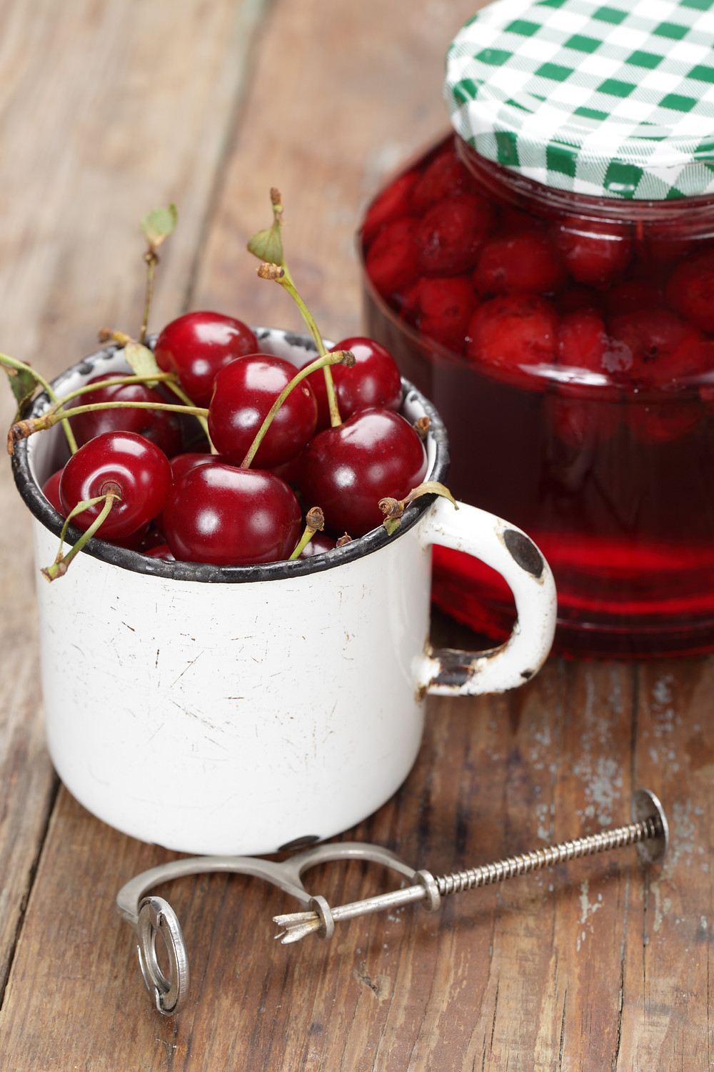 cherry picker with cup of cherries