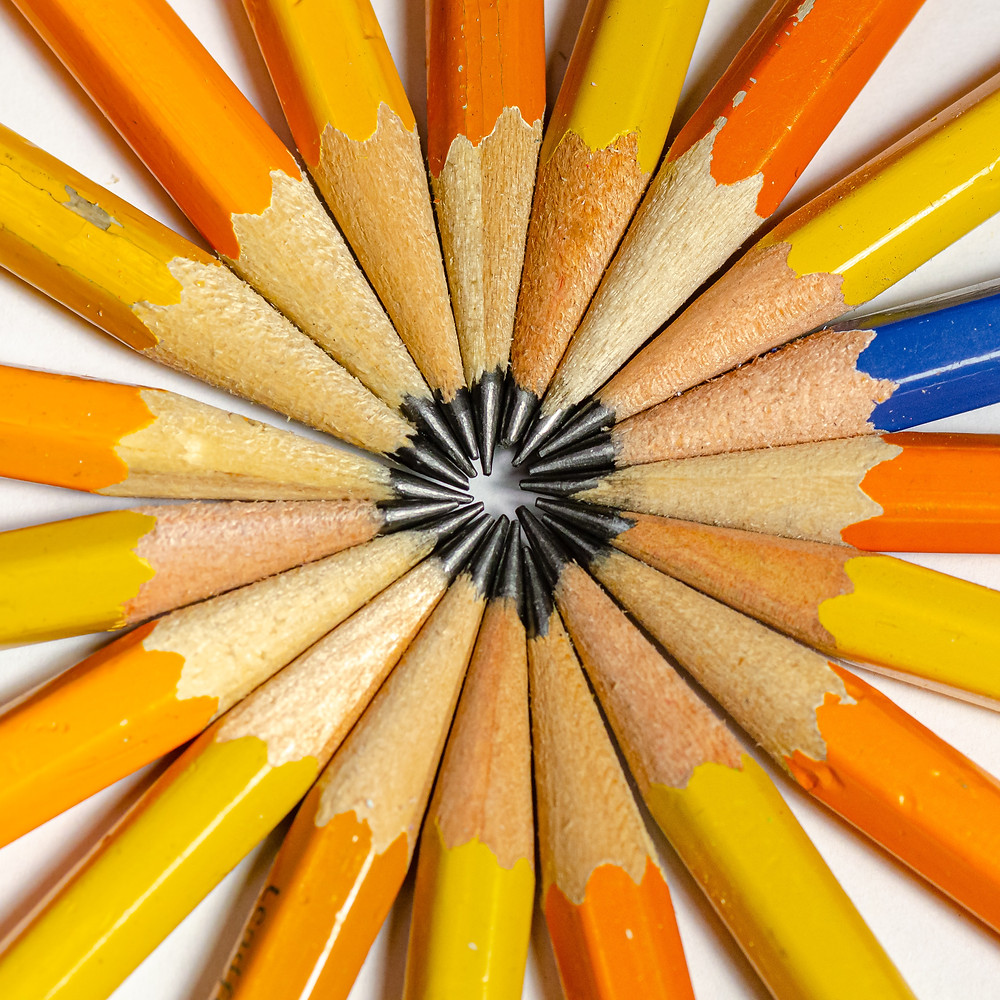 sharpened pencils with points forming a circle