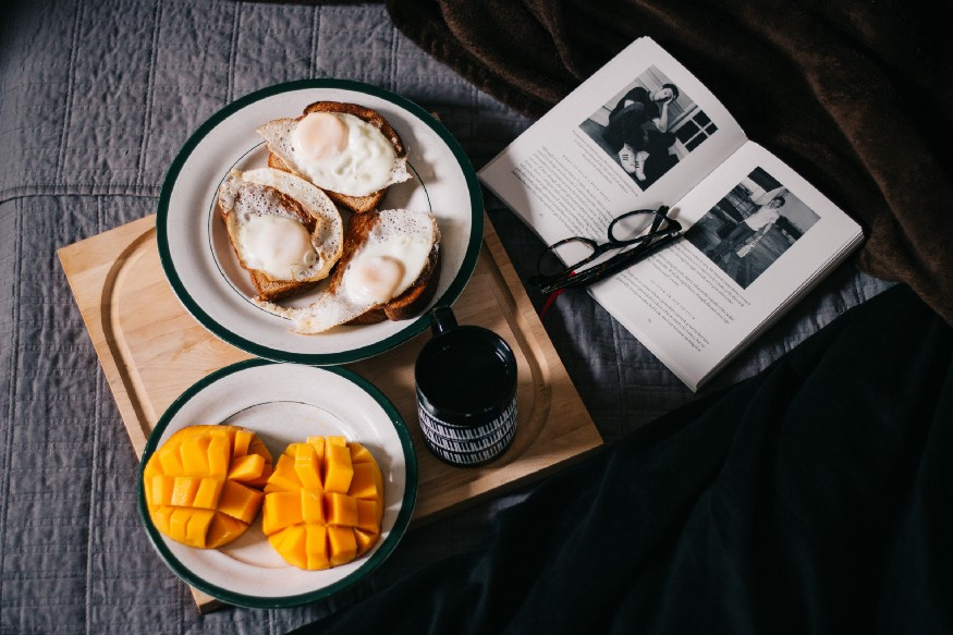 tray of food next to open book