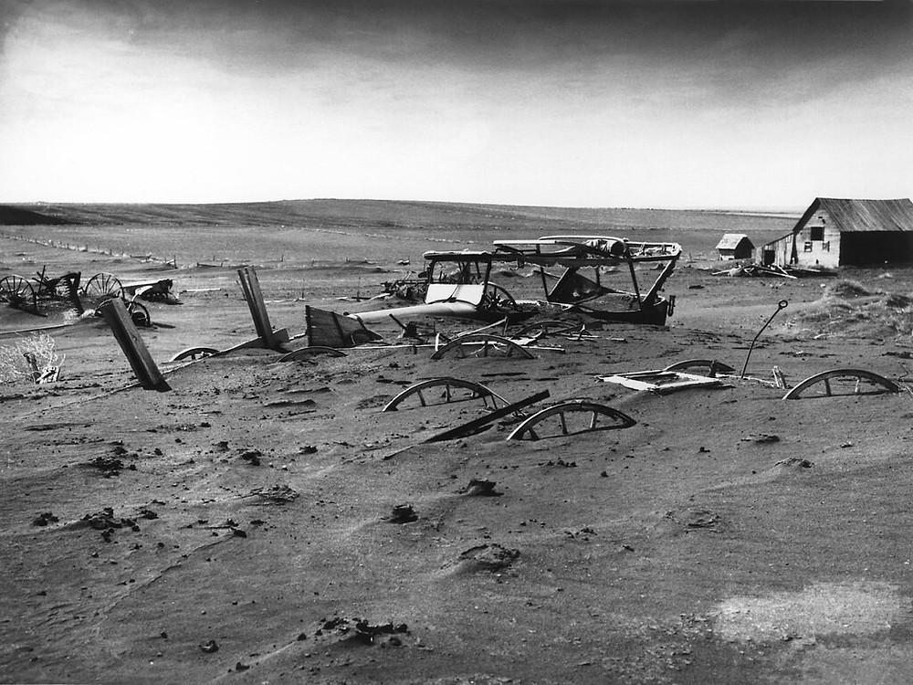 B&W photo of texas farm after dust storm