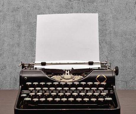 typewriter-with-blank-paper.jpg