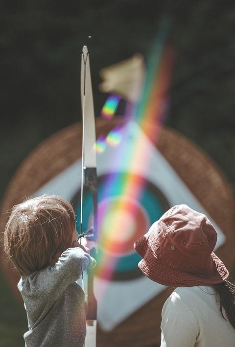 Child learning archery_edited.jpg