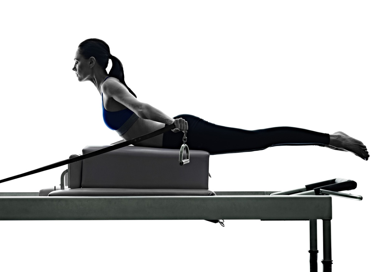 bigstock-woman-pilates-reformer-exercis-136105703_edited