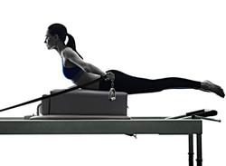 bigstock-woman-pilates-reformer-exercis-136105703_edited