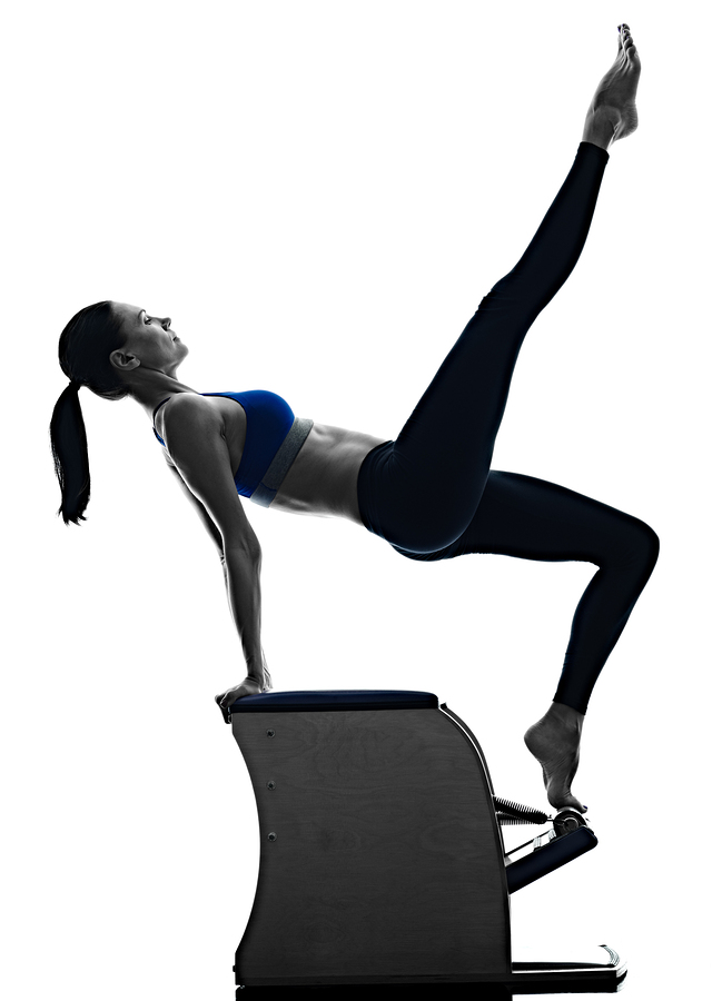 bigstock-woman-pilates-chair-exercises--116672042