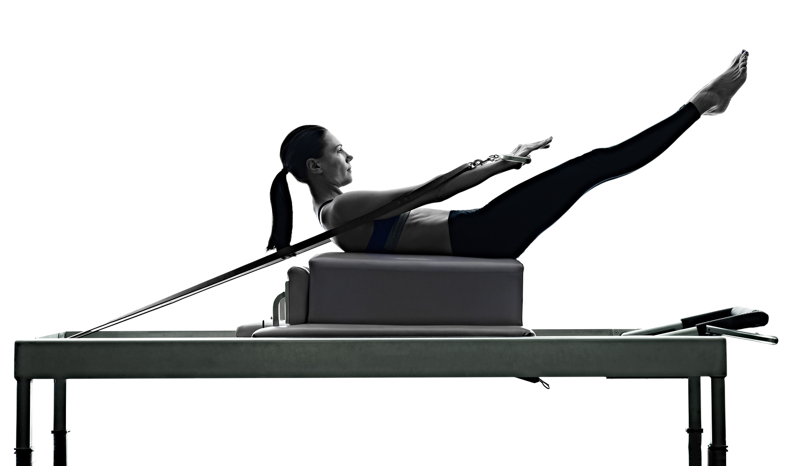 bigstock-woman-pilates-reformer-exercis-140056100