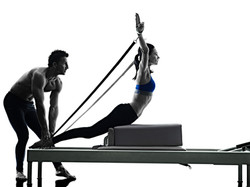 bigstock-couple-pilates-reformer-exerci-128215613