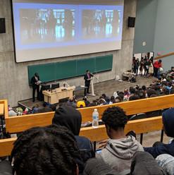 "At the ""We Rise"" symposium"