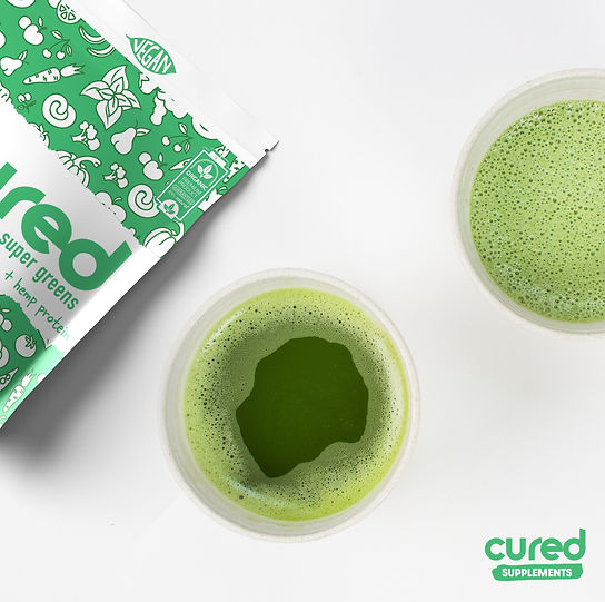 super greens in glass by Cured Supplements