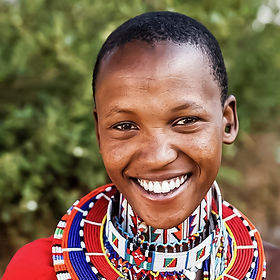 An artist from the group 'Mama Masai' in