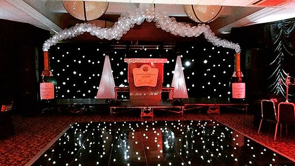 Twinkling Champagne bottle  arch to fram