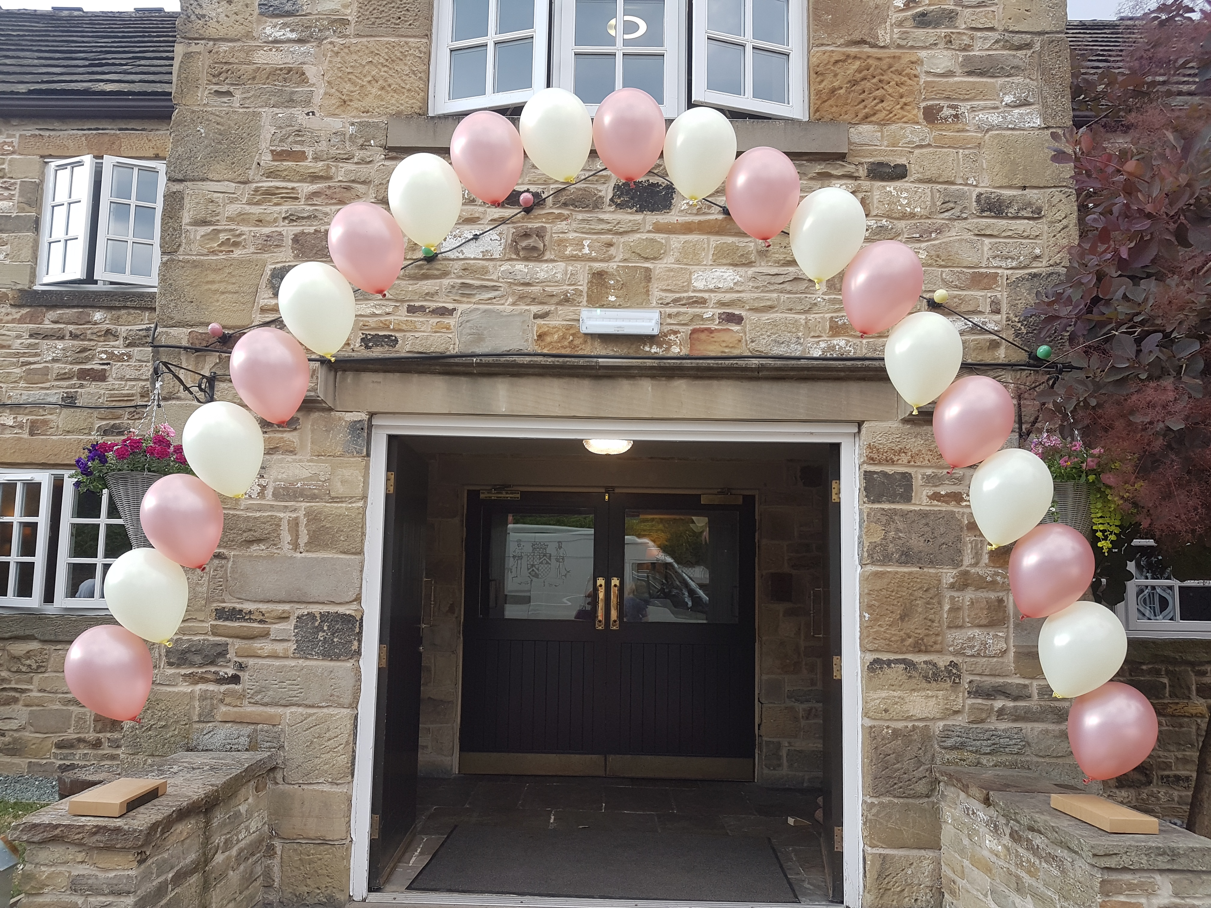 Pink and ivory over door arch