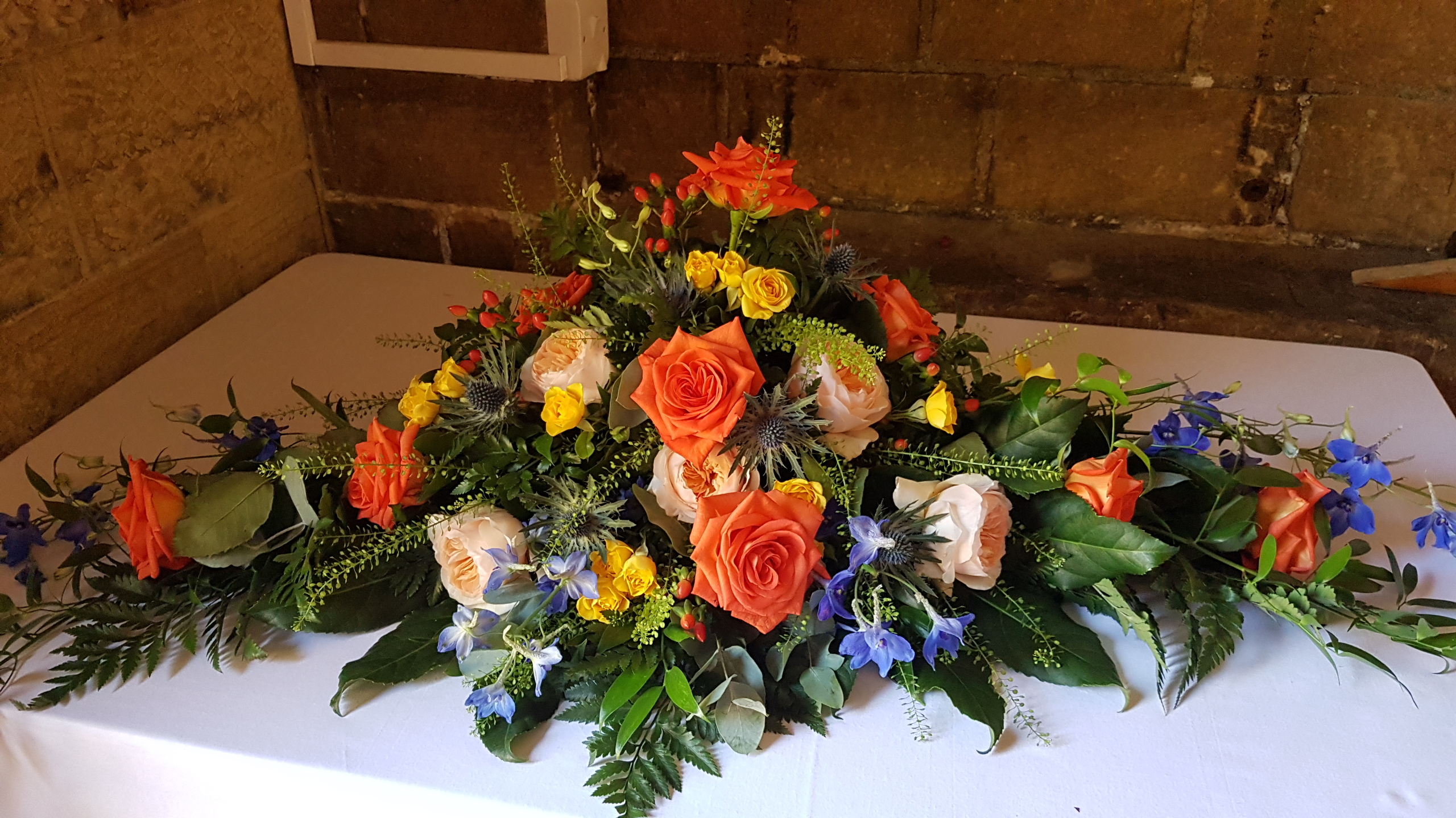 Fresh orange, yellow & blue top table decoration
