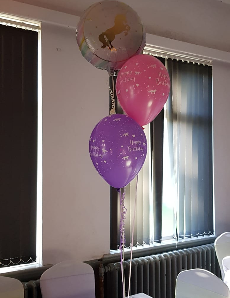 Unicorn foil topped with 2 latex trios of balloons